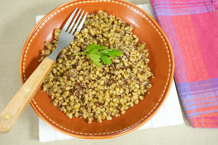 plate of wheat, red rice and quinoa on a table