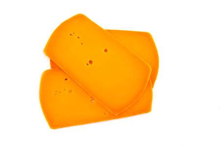 sliced orange cheese on a white background Stock Photo