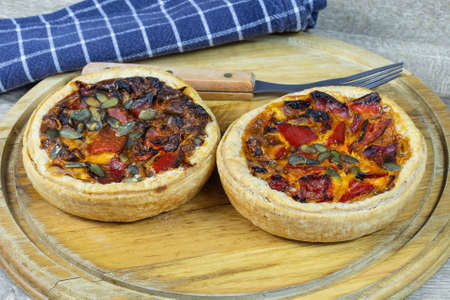 Vegetarian tart with grilled vegetables and pumpkin seeds