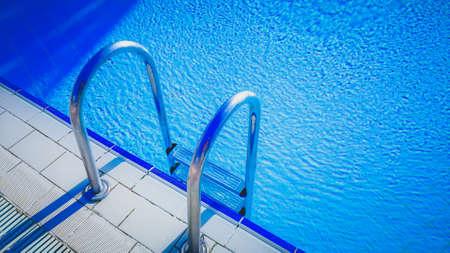 pool edge with aluminum pool steps