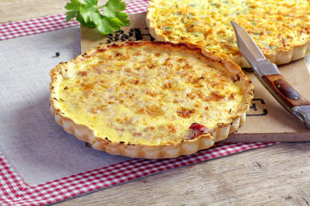 quiche lorraine and leek quiche on a table