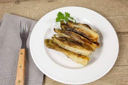 several braised endives in a plate