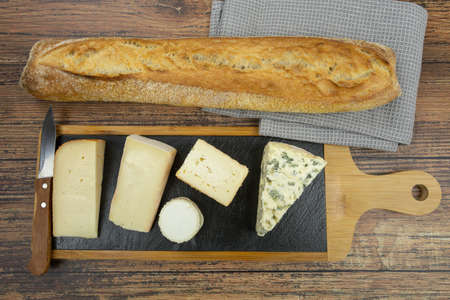 cheese board and bread on a table
