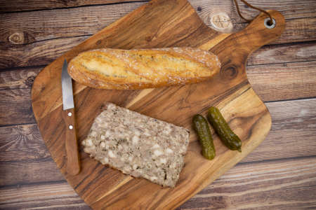 slices of country pâté and baguette on a cutting board Banque d'images