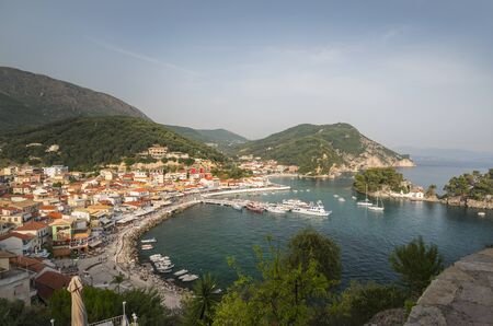 the city of Parga, by the mediterranean sea, with it's houses and boats in the pier