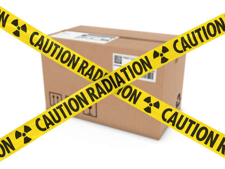 barrier tape: Radioactive Attack Parcel Concept - Cardboard Box behind Caution Radiation Tape Cross Stock Photo