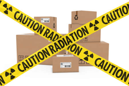 cardboard boxes: Radioactive Attack Parcels Concept - Stack of Cardboard Boxes behind Caution Radiation Tape Cross