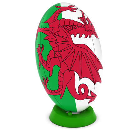 welsh: Wales Rugby - Welsh Flag on Standing Rugby Ball Stock Photo