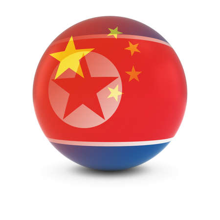 korean flag: Chinese and North Korean Flag Ball - Fading Flags of China and North Korea Stock Photo