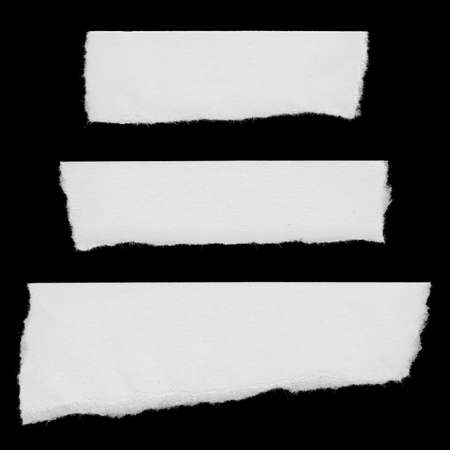 scan paper: Torn White Paper Strips Isolated on Black Background