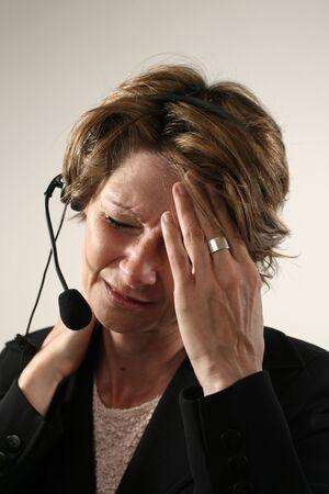 片頭痛を持つ女性