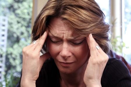 woman with migraine Stock Photo