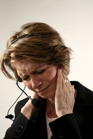 receptionist with headache Stock Photo - 242190