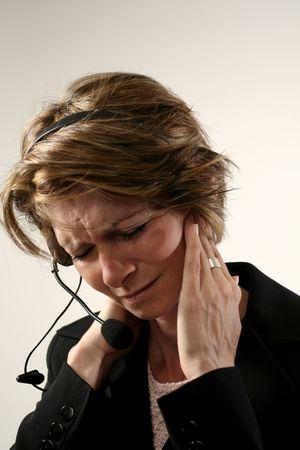 receptionist with headache Stock Photo - 242190