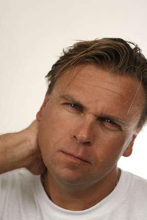 首の痛みを持つ男 写真素材