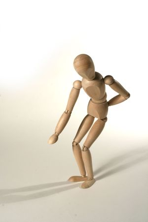 wood figurine with back pain Stock Photo