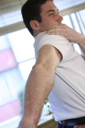 boy with shoulder pain Stock Photo
