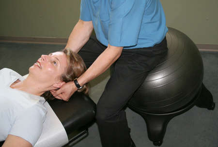 adjusted: woman being adjusted by a chiropractor