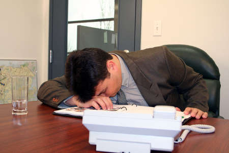 man sleeping at work Stock Photo