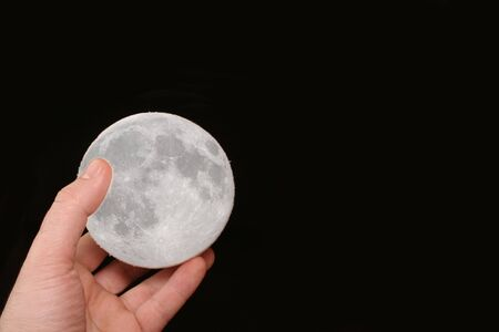 nightime: moon in hand Stock Photo