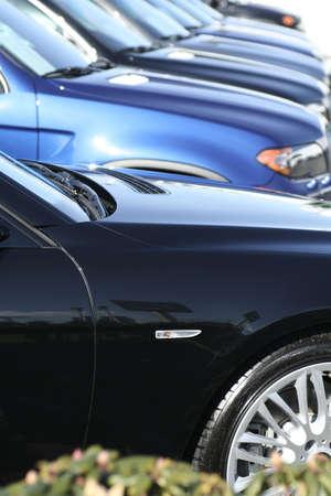 mileage: dealership car lined up