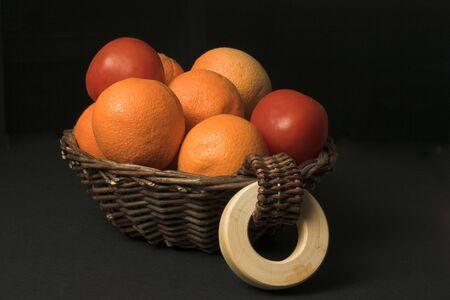 fruit basket over black photo
