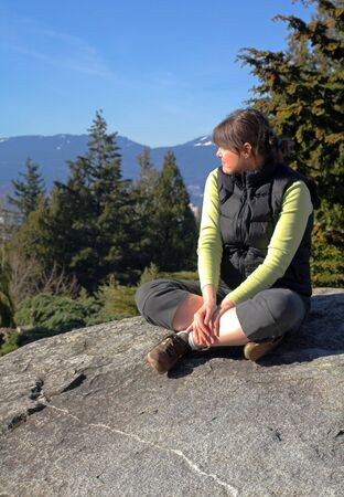 woman resting after hiking