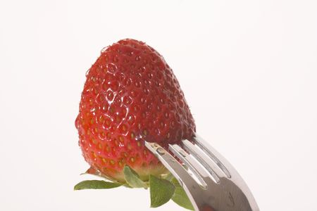 strawberry on fork photo