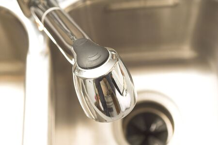 plumb: faucet and sink close up