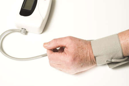 senior taking blood pressure over white Stock Photo - 374486