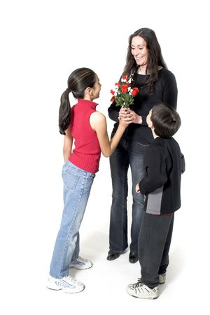 daughter and son offering flowers to her mother photo