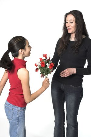 daughter offering flowers to her mother photo