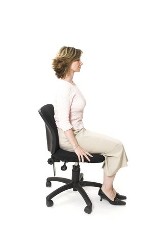buena postura: mujer que se sienta en buena postura Foto de archivo