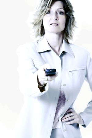 controling: woman holding remote in blue tone close up