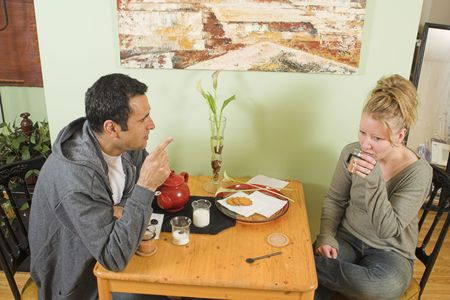 couple arguing at table Stock Photo