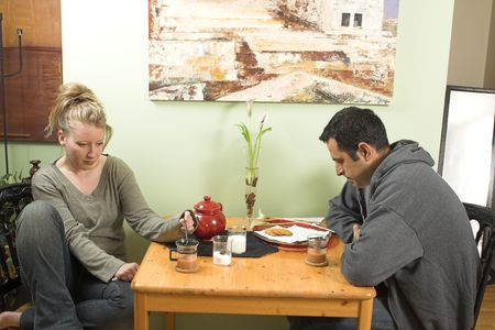 couple arguing at table photo