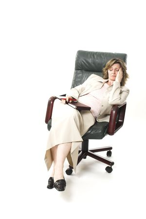 business woman relaxing on chair over white photo