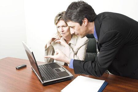 business people in meeting with laptop