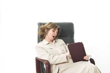 business woman yawning on chair over white photo