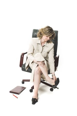 business woman leg fatigue over white