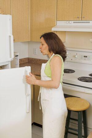woman opening fridge photo