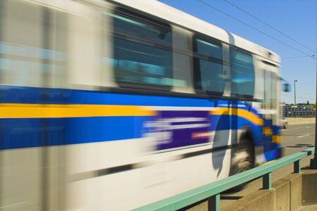 bus passing fast on bridge