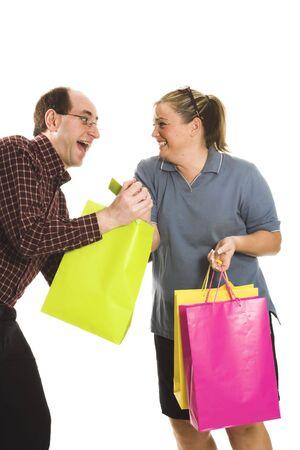 couple having fun with shopping bags