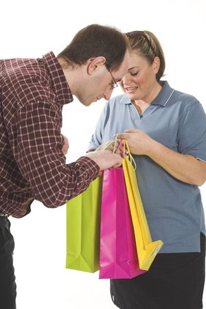 couple with shopping bags over white background photo