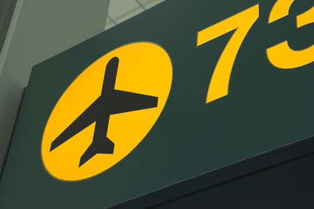 embark: airport green and yellow sign