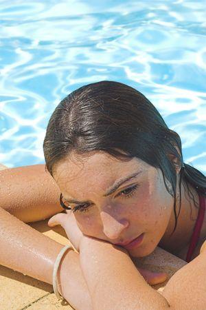 sad teen: sad teen by the pool
