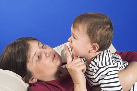 mother calming down her baby Stock Photo - 511993