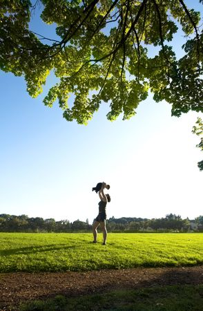 mother and son on a field