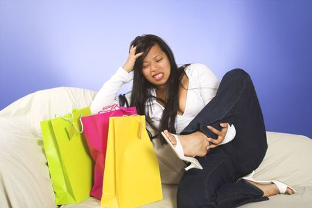 leg pain after shopping Stock Photo