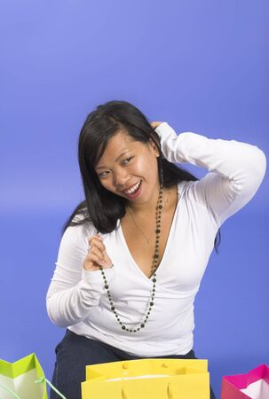 neckless: woman with neckless over blue background